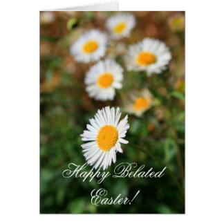 La margarita de pascua tardía feliz florece la tarjeta de felicitación
