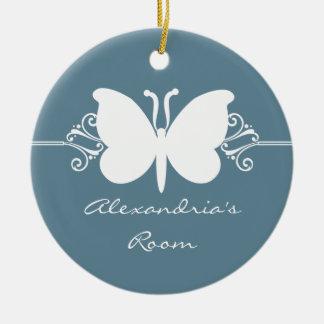 La mariposa azul descolorada remolina ornamento de adorno navideño redondo de cerámica