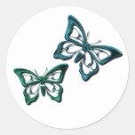 La mariposa azul diseña al pegatina