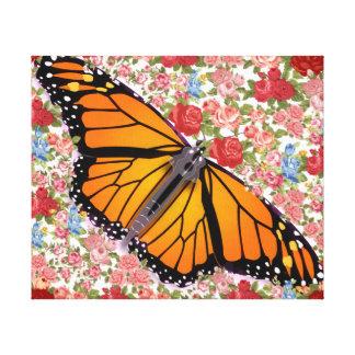 La mariposa con las flores envolvió la lona (el impresion en lona