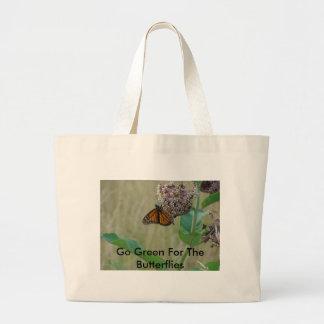 La mariposa en la flor del Milkweed, va verde para Bolsa Tela Grande