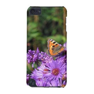 La mariposa en púrpura florece la caja de iPod