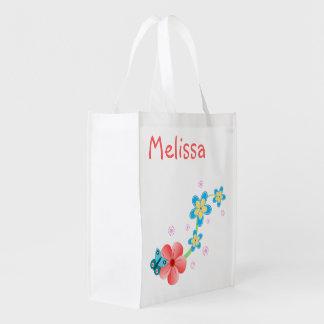 La mariposa en rosado y azul florece bolsos bolsas reutilizables
