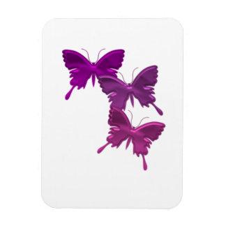 La mariposa púrpura diseña el imán superior