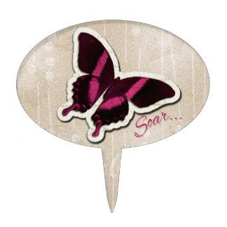 La mariposa rosada se eleva en fondo beige figuras para tartas