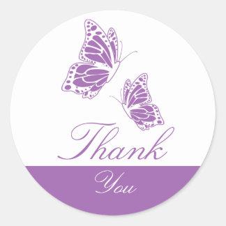 La mariposa violeta simple le agradece pegatina redonda