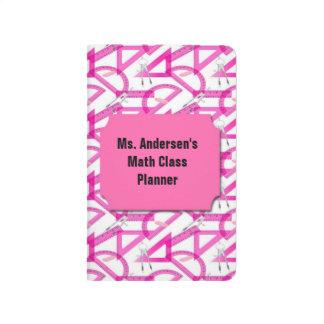 La matemáticas rosada de los profesores equipa el cuaderno grapado