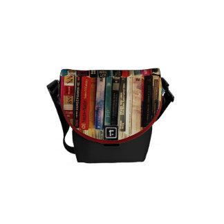 La mini bolsa de mensajero de los libros bolsas de mensajeria