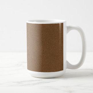 La mirada comodamente de la textura de la gamuza taza