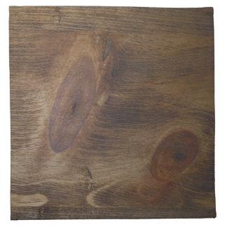La mirada de madera nudosa rústica bonita anuda el servilletas
