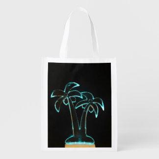 La mirada del Lit de neón encima de las palmeras Bolsa Reutilizable