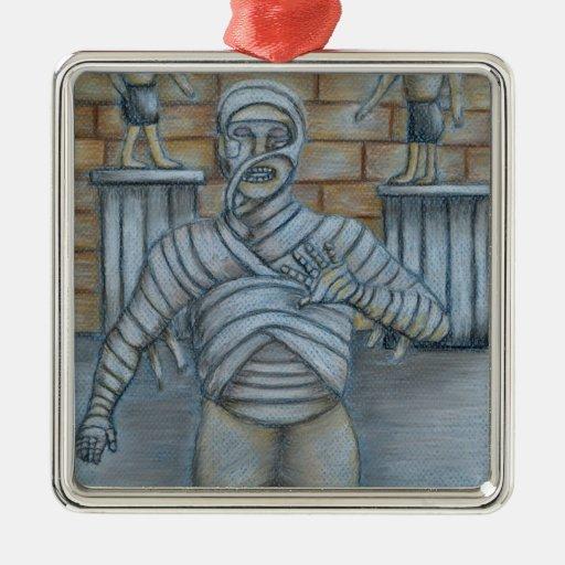 La momia adorno cuadrado plateado
