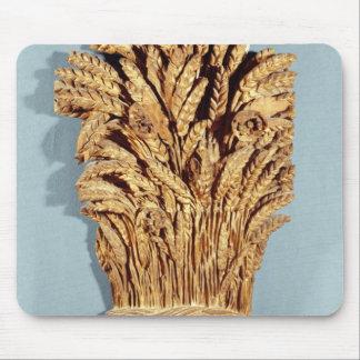 La muestra del panadero con los oídos del trigo y  mouse pads