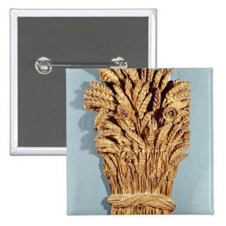 La muestra del panadero con los oídos del trigo y  pin cuadrado