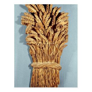 La muestra del panadero con los oídos del trigo y postales