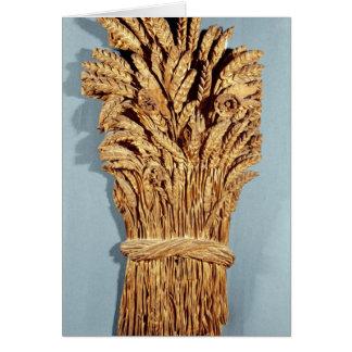 La muestra del panadero con los oídos del trigo y  tarjeta de felicitación