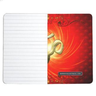 La muestra OM en oro Cuadernos Grapados