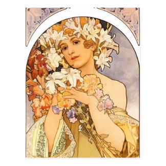 La mujer con las flores postales