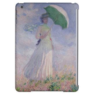 La mujer con un parasol dio vuelta a la derecha, 1
