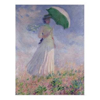 La mujer con un parasol dio vuelta a la derecha, postal