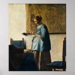 La mujer de Vermeer en azul que lee una letra ca.1 Impresiones