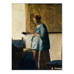 La mujer de Vermeer en azul que lee una letra Postal