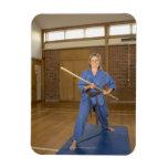 La mujer que se realiza Ken-Hace-Kai karate, sonri Iman Rectangular