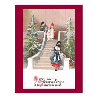 La mujer tienta navidad del vintage de los niños postales