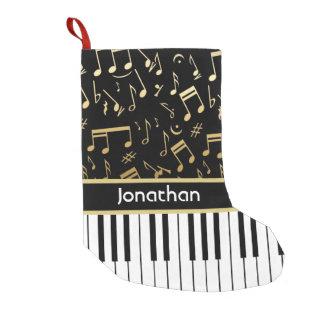 La música de oro elegante observa llaves del piano calcetín de navidad pequeño