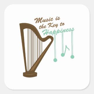 La música es la llave a la felicidad pegatina cuadrada