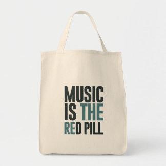 La música es la píldora roja bolsas de mano