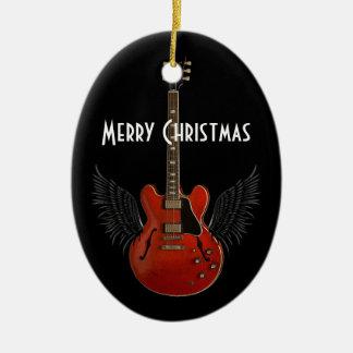 La música es ornamento del navidad del cielo adorno navideño ovalado de cerámica
