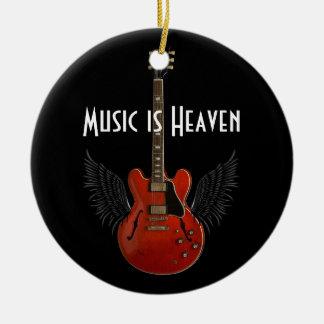 La música es ornamento redondo del navidad del adorno navideño redondo de cerámica