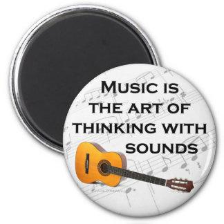 La música está pensando con la guitarra de los son imán redondo 5 cm