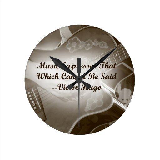 La música expresa ese decir de la foto de la guita reloj de pared