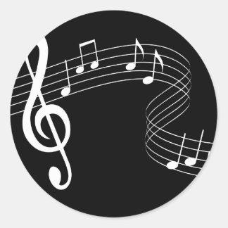 La música fluye blanco en el pegatina negro