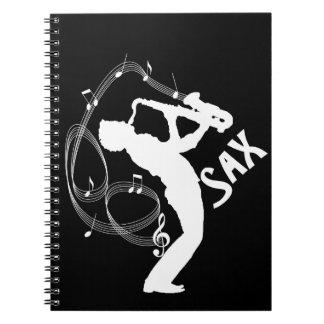 La música observa a músicos del jugador de saxofón notebook