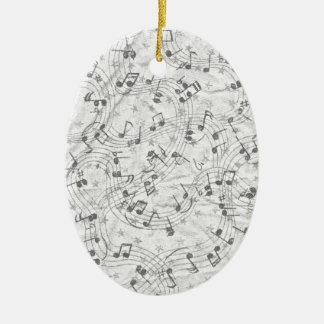 La música observa blanco y negro adorno navideño ovalado de cerámica