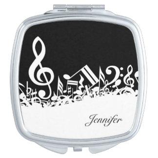 La música observa el acuerdo con nombre de encargo espejos para el bolso