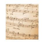 La música observa el fondo bloc de papel