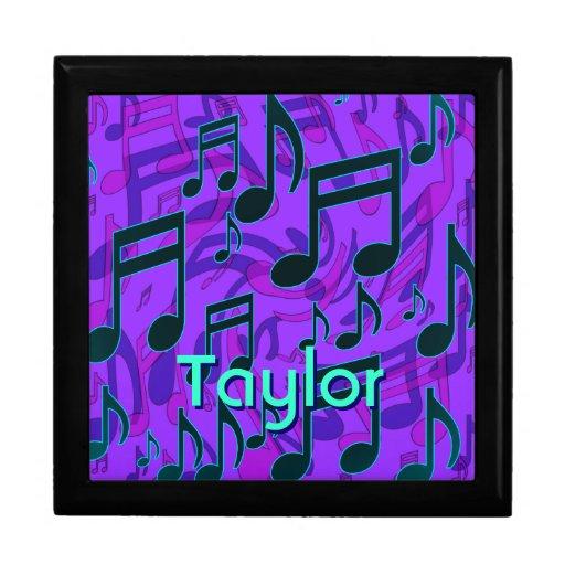 La música observa la púrpura del verde azul de la cajas de regalo