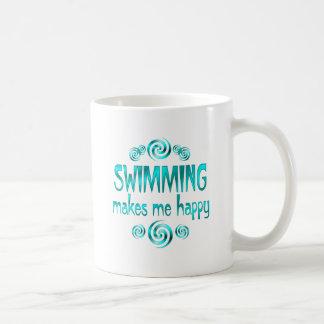 La natación me hace feliz tazas