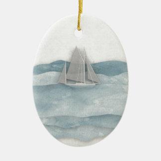 La nave flotante adorno navideño ovalado de cerámica