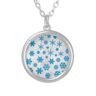La nieve azul linda del brillo forma escamas en el grimpolas personalizadas