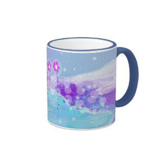 La nieve florece la taza