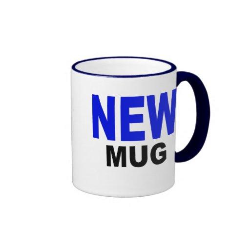 "La nueva taza, regalo, texto lee, ""NUEVA TAZA """