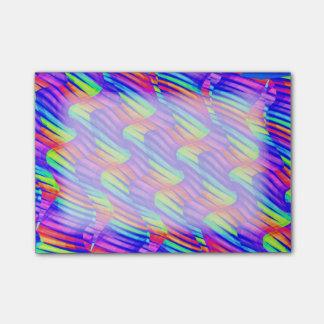 La onda brillante colorida del arco iris tuerce la post-it notas