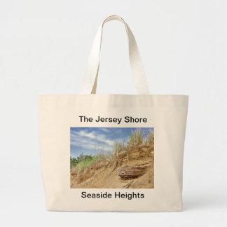 La orilla del jersey en las alturas de la playa bolsas de mano