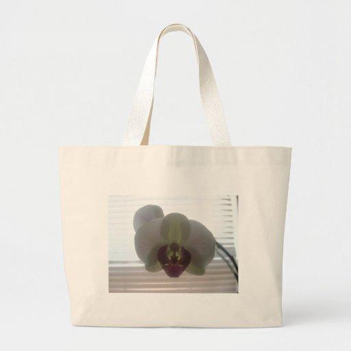 La orquídea florece los jardines rosados del desti bolsa de mano