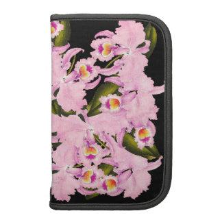La orquídea tropical florece el folio floral de planificadores